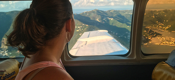 Lady looking at plane window