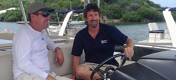 Captain at helm of power catamaran