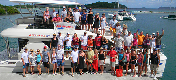 Big group on power catamaran and docks