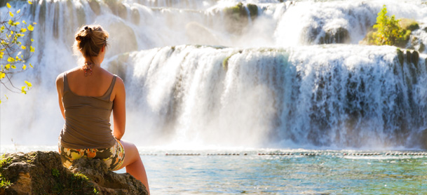 Woman relaxing watching waterfalls