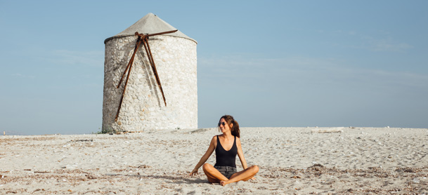 Woman sitting in sand