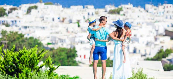 Family together overlooking Greece cityscape