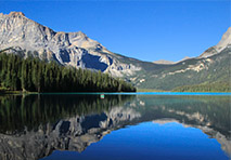 serene water with mountain in background