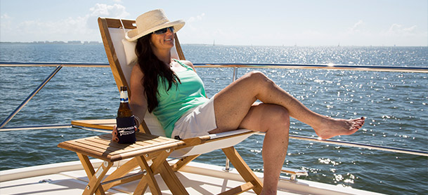 Lady relaxing in chair on boat