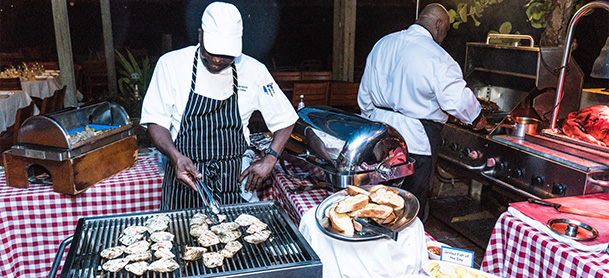 Chefs cooking at event in the BVI