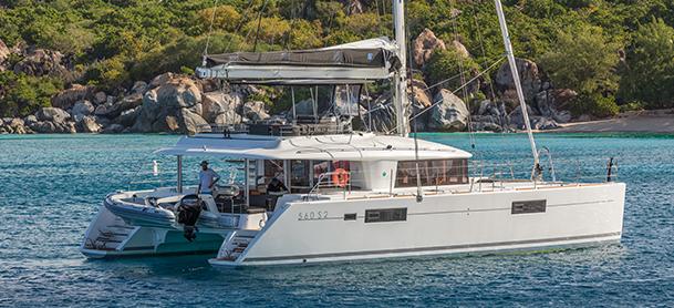 Power catamaran sitting in front of island