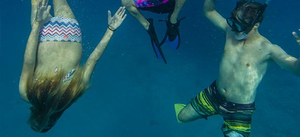 Children underwater snorkeling in the BVI
