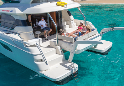 People relaxing aboard the MarineMax 443
