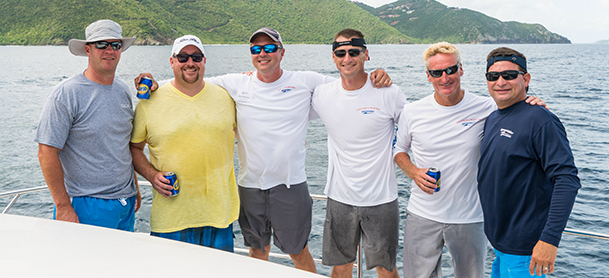 Group of Guys on Power Catamaran Charter