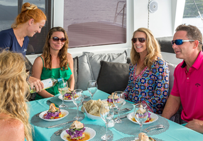 Dining aboard a power charter