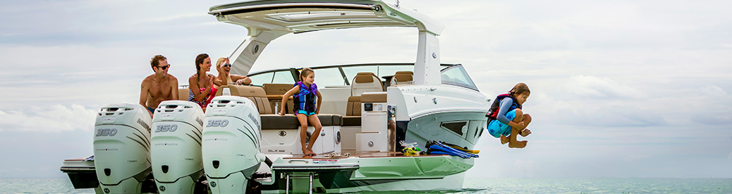 A child jumping off a boat