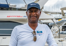 clarence malone standing in front of a marine max yacht