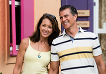 couple walking down colorful street on vacation