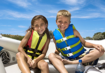 two kids in life jackets