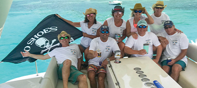 A group of people aboard a MarineMax Vacations power catamaran