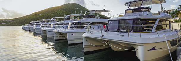 MarineMax Vacations Power Catamaran Fleet at the Docks