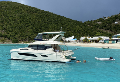 An Aquila power catamaran off the coast of Jost van Dyke