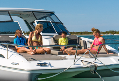 family on bow of MarineMax 362