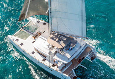 Sail catamaran cruising across sea