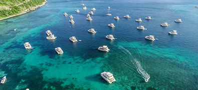 a lot of marinemax vacations power catamarans moored in the british virgin islands