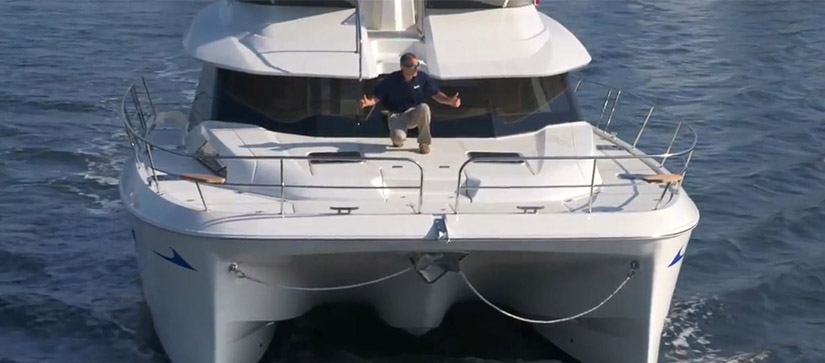 man on the front of a boat on the water