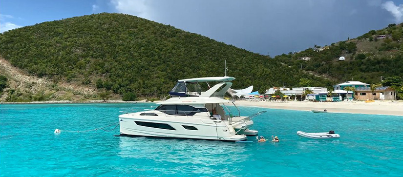 An Aquila power catamaran in front of the Soggy Dollar in the British Virgin Islands