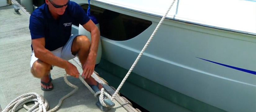 Man tying dock lines