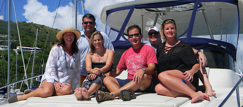 Group lounging on flybridge of Power Catamaran.