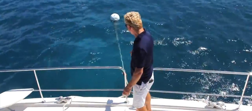 Man explaining how to pick up a mooring ball