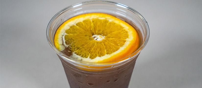purple drink in a cup with an orange