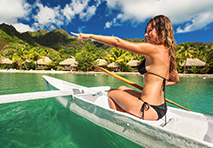 woman rowing a boat in french polynesia