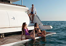 People relaxing aboard a yacht