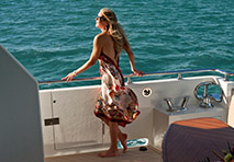 woman standing on yacht deck looking out to the water