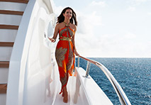 Woman walking down side deck of a yacht