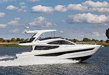 Galeon yacht cruising through water