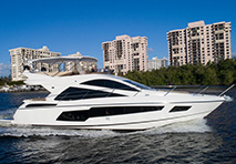 profile view of the sunseeker 55 yacht cruising through blue water