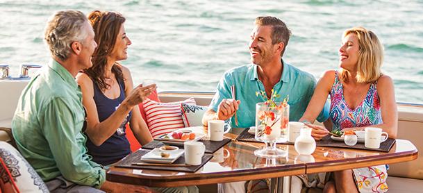 Two couples enjoying sushi aboard a yacht
