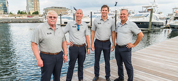 yacht brokerage team on the docks