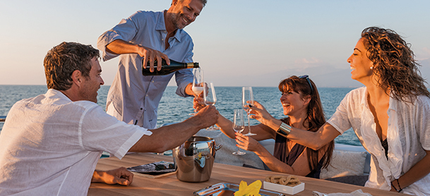 Enjoying a bottle of wine aboard yacht