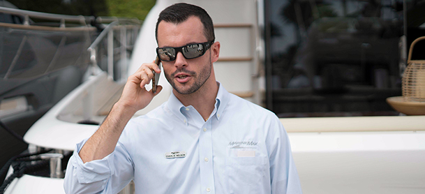 Yacht broker on cell phone