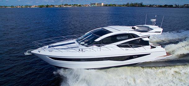 Yacht racing along water