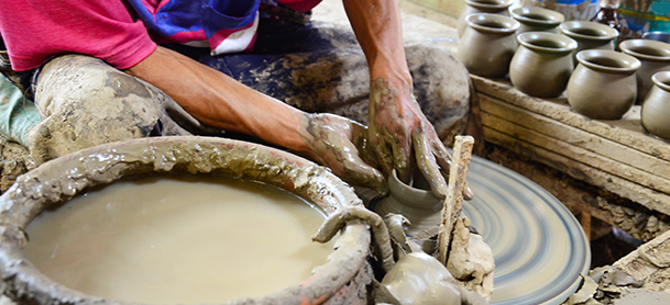 A close-up shot of a person working with pottery