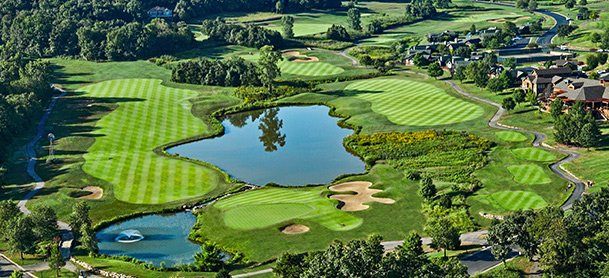 Aerial shot of a golf course with two bodies of water in the middle