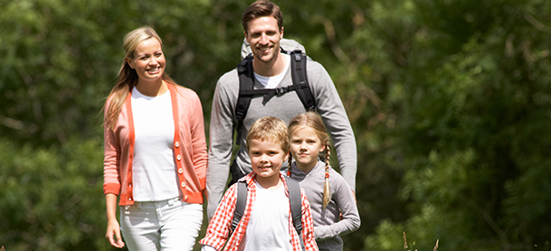 A family with two young children go hiking