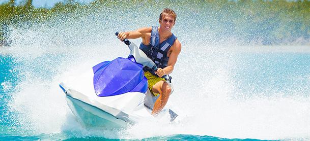 A man turns a jetski and creates a wave