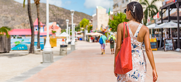 Woman with red handback walking in shopping area
