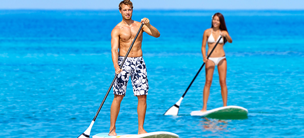 Man and woman paddleboarding