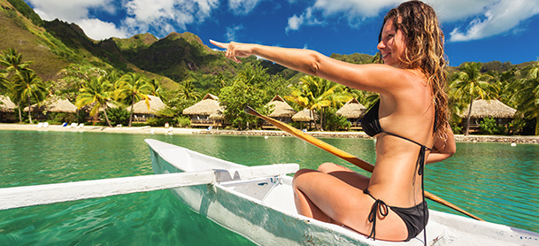 Woman in paddle boat in water