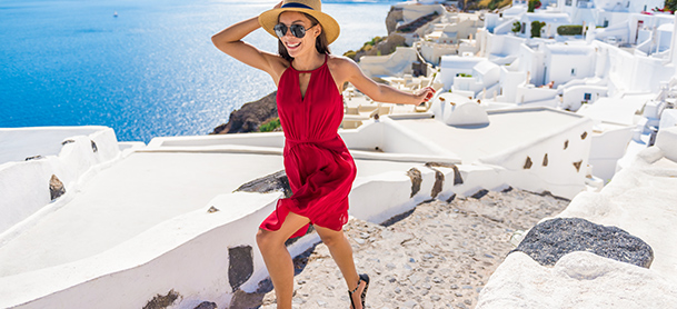 Woman in red dress running along a brick pathway