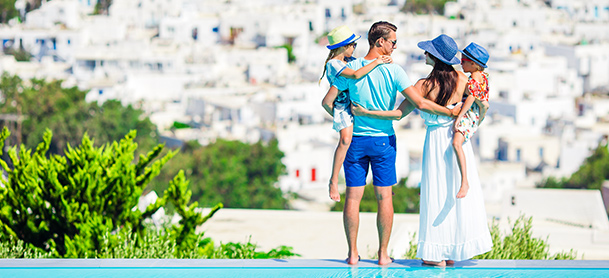 Family overlooking city in Greece